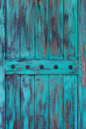 Rustic antique aqua blue wood door background with rusty iron bolts for texture Stock fotó