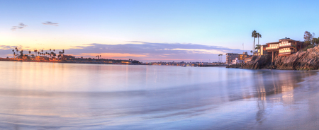 water  panoramic: Sunset over the harbor in Corona del Mar, California at the beach in the United States Stock Photo