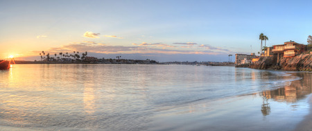 Sunset over the harbor in Corona del Mar, California at the beach in the United States Stock Photo