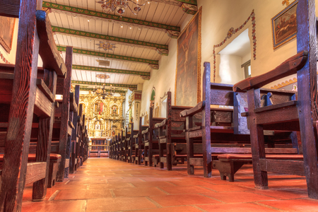 pews: San Juan Capistrano, CA, USA —September 25, 2016:  Serra Chapel at the Mission San Juan Capistrano in Southern California, United States. Editorial use only. Editorial