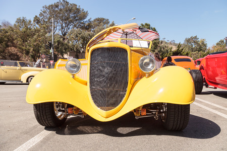 Laguna Beach, CA, USA - October 2, 2016: Yellow 1934 Ford Roadster owned by Mauricio Vivanco and displayed at the Rotary Club of Laguna Beach 2016 Classic Car Show. Editorial use.