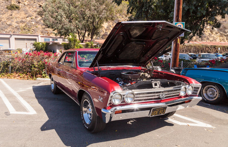 chevy: Laguna Beach, CA, USA - October 2, 2016: Red 1967 Chevy Chevelle SS Coupe owned by Phillip Capuano and displayed at the Rotary Club of Laguna Beach 2016 Classic Car Show. Editorial use.