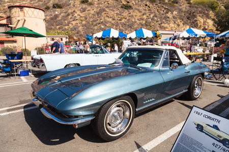 chevy: Laguna Beach, CA, USA - October 2, 2016: Blue 1967 Chevy Stingray owned by Alexander Vracin and displayed at the Rotary Club of Laguna Beach 2016 Classic Car Show. Editorial use.