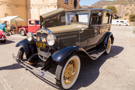 show window: Laguna Beach, CA, USA - October 2, 2016: Tan 1931 Ford Slant Window Town Sedan owned by David and Susie Russell and displayed at the Rotary Club of Laguna Beach 2016 Classic Car Show. Editorial use.