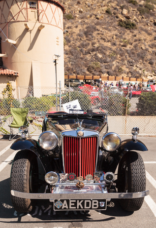 Laguna Beach, CA, USA - October 2, 2016: Black and Red 1947 MG TC classic car owned by Tom Harkenrider and displayed at the Rotary Club of Laguna Beach 2016 Classic Car Show. Editorial use. Editorial