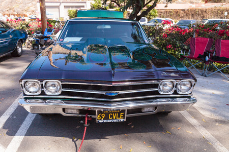 chevy: Laguna Beach, CA, USA - October 2, 2016: Green and blue 1969 Chevy Chevelle owned by John Pettinato and displayed at the Rotary Club of Laguna Beach 2016 Classic Car Show. Editorial use. Editorial