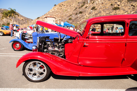 jeffrey: Laguna Beach, CA, USA - October 2, 2016: Red 1933 Ford 40 sedan owned by Jeffrey Counseller and displayed at the Rotary Club of Laguna Beach 2016 Classic Car Show. Editorial use.