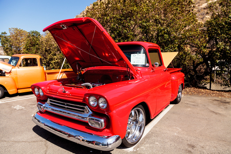 Laguna Beach, CA, USA - October 2, 2016: Red 1958 Chevy Step Side owned by Jimmy Perez and displayed at the Rotary Club of Laguna Beach 2016 Classic Car Show. Editorial use.