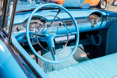 bel air: Laguna Beach, CA, USA - October 2, 2016: Blue 1955 Chevrolet Bel Air convertible owned by Gary Paolucci and displayed at the Rotary Club of Laguna Beach 2016 Classic Car Show. Editorial use.