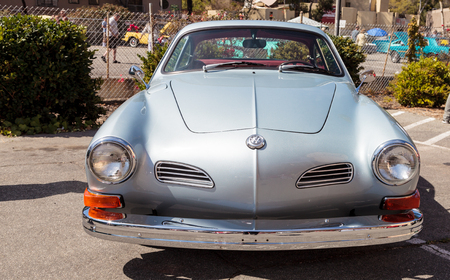 vw: Laguna Beach, CA, USA - October 2, 2016: Silver 1972 VW Karmann Ghia owned by Ike and Ramila Madouras and displayed at the Rotary Club of Laguna Beach 2016 Classic Car Show. Editorial use.
