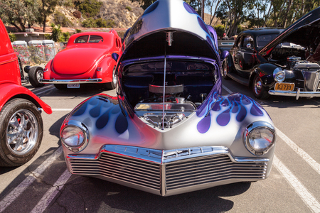 Laguna Beach, CA, USA - October 2, 2016: Blue with silver flames 1946 Studebaker Champion owned by Jim Magill and displayed at the Rotary Club of Laguna Beach 2016 Classic Car Show. Editorial use.