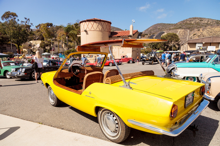 fiat: Laguna Beach, CA, USA - October 2, 2016: Yellow 1970 Fiat Schiller with wicker seats owned by Jim Roy and displayed at the Rotary Club of Laguna Beach 2016 Classic Car Show. Editorial use.
