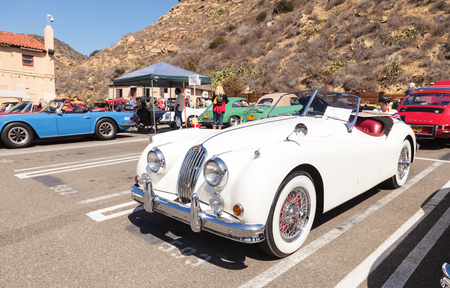 mc: Laguna Beach, CA, USA - October 2, 2016: White 1956 Jaguar XK 140 MC formerly owned by Alex Trebek and now owned Robert Huntington and displayed at the Rotary Club of Laguna Beach 2016 Classic Car Show. Editorial use.