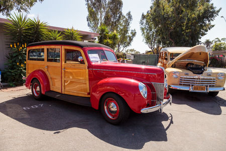 Laguna Beach, CA, USA - October 2, 2016: Red 1940 Ford Woody owned by John Phillips and displayed at the Rotary Club of Laguna Beach 2016 Classic Car Show. Editorial use.