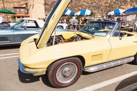 Laguna Beach, CA, USA - October 2, 2016: Yellow 1967 Chevrolet corvette owned by David and Kathy Stachovitz and displayed at the Rotary Club of Laguna Beach 2016 Classic Car Show. Editorial use.