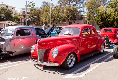 reese: Laguna Beach, CA, USA - October 2, 2016: Red 1940 Ford Deluxe Opera Coupe owned by Susan Reese and displayed at the Rotary Club of Laguna Beach 2016 Classic Car Show. Editorial use.