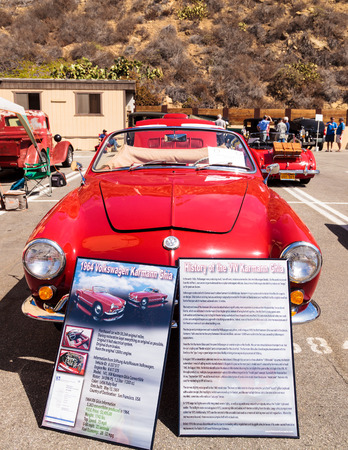 laguna: Laguna Beach, CA, USA - October 2, 2016: Red 1964 VW Karmann Ghia convertible owned by Jim Keefe and displayed at the Rotary Club of Laguna Beach 2016 Classic Car Show. Editorial use.