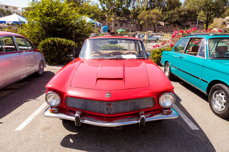 Laguna Beach, CA, USA - October 2, 2016: Red classic 1964 Rivolta GT Coupe owned by Ted Hirth and displayed at the Rotary Club of Laguna Beach 2016 Classic Car Show. Editorial use. Editorial