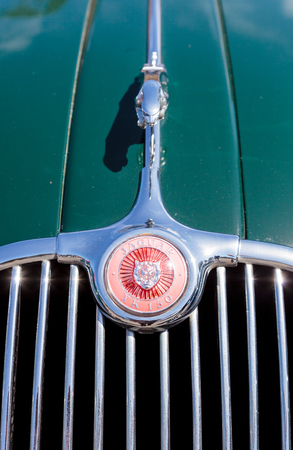 hathaway: Laguna Beach, CA, USA - October 2, 2016: Green 1958 Jaguar XK 150 owned by Hathaway and displayed at the Rotary Club of Laguna Beach 2016 Classic Car Show. Editorial use.