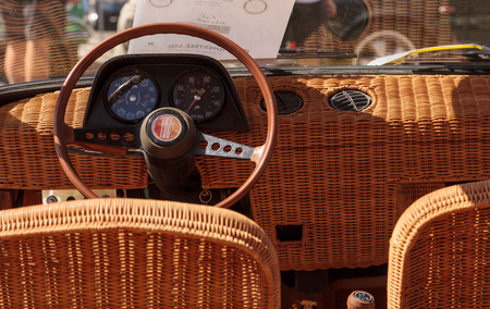 roy: Laguna Beach, CA, USA - October 2, 2016: Yellow 1970 Fiat Schiller with wicker seats owned by Jim Roy and displayed at the Rotary Club of Laguna Beach 2016 Classic Car Show. Editorial use.