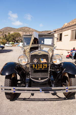 beach window: Laguna Beach, CA, USA - October 2, 2016: Tan 1931 Ford Slant Window Town Sedan owned by David and Susie Russell and displayed at the Rotary Club of Laguna Beach 2016 Classic Car Show. Editorial use.