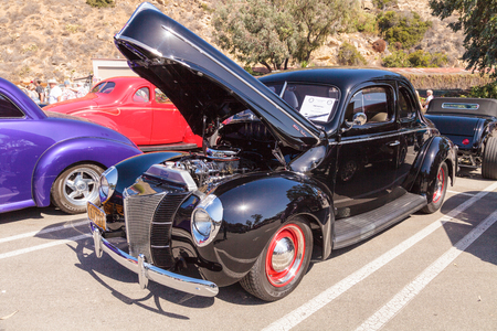 Laguna Beach, CA, USA - October 2, 2016: Black 1940 Ford Deluxe Sedan owned by Rob Stinson and displayed at the Rotary Club of Laguna Beach 2016 Classic Car Show. Editorial use. Editorial