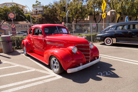 chevy: Laguna Beach, CA, USA - October 2, 2016: Red 1939 Chevy Coupe owned by Ken Biggs and displayed at the Rotary Club of Laguna Beach 2016 Classic Car Show. Editorial use.