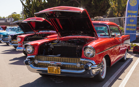 bel air: Laguna Beach, CA, USA - October 2, 2016: Red 1957 Chevrolet Bel Air 2 Door Hardtop owned by Len Yerkes and displayed at the Rotary Club of Laguna Beach 2016 Classic Car Show. Editorial use.