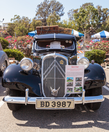 traction: Laguna Beach, CA, USA - October 2, 2016: This black 1954 Citroen Traction Avant was driven in South Africa and Botswana for 20 years before ending up in a barn in Quebec, Canada for 30 years. It was restored and is now owned by Rodney Pick and was display Editorial