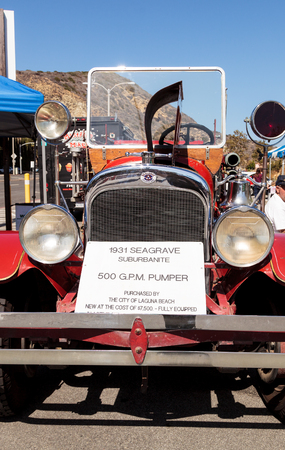 PUMPER: Laguna Beach, CA, USA - October 2, 2016: Red 1931 Seagrave Suburbanite 500 GPM Pumper fire engine owned by the city of Laguna Beach and displayed at the Rotary Club of Laguna Beach 2016 Classic Car Show. Editorial use.