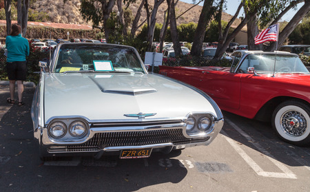 show bill: Laguna Beach, CA, USA - October 2, 2016: Silver 1963 Ford Thunderbird owned by Bill Waldmann and displayed at the Rotary Club of Laguna Beach 2016 Classic Car Show. Editorial use. Editorial