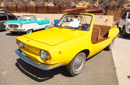 Laguna Beach, CA, USA - October 2, 2016: Yellow 1970 Fiat Schiller with wicker seats owned by Jim Roy and displayed at the Rotary Club of Laguna Beach 2016 Classic Car Show. Editorial use.
