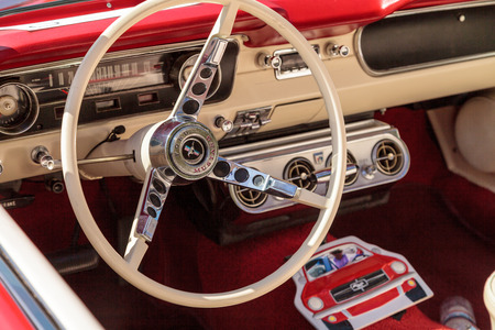 laguna: Laguna Beach, CA, USA - October 2, 2016: Red 1965 Ford Mustang owned by Beverly Morgan and displayed at the Rotary Club of Laguna Beach 2016 Classic Car Show. Editorial use.