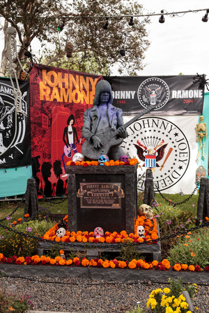 alter: Los Angeles, CA, USA - October 29, 2016: Flower and skeleton alter for Johnny Ramone at Dia de los Muertos, Day of the dead, in Los Angeles at the Hollywood Forever Cemetery grounds. Editorial use only.