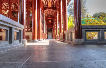 koi: Los Angeles, CA, USA – November 25, 2016: Long hallway path in the Chinese garden at the Huntington Botanical Gardens in Los Angeles, California. Editorial use.