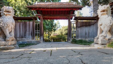 chinese garden: Los Angeles, CA, USA – November 25, 2016: Entrance with Chinese garden view with lion statues in the Chinese garden at the Huntington Botanical Gardens in Los Angeles, California. Editorial use. Stock Photo