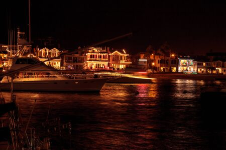 Colorful holiday lights on sailboats and ships in the Balboa Harbor for the Newport Beach Christmas Boat Parade.