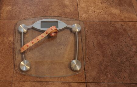 Scale to monitor weight with a measuring tape to take measurements to keep track of physical fitness