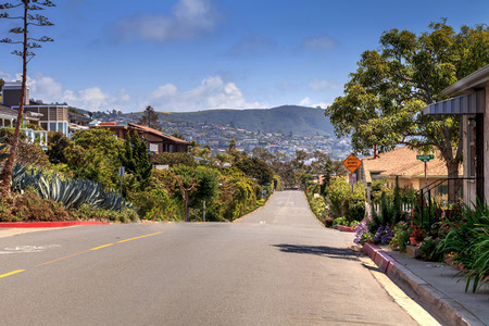Blue sky above Hillcrest Drive roadside in Laguna Beach, California, USA Фото со стока