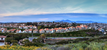 Panoramic view of tract homes along the Dana Point coast at sunset in Southern California, USA