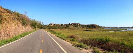 Newport Back Bay loop hiking trail winds along the marsh, where you will see wildlife in Newport Beach, California USA
