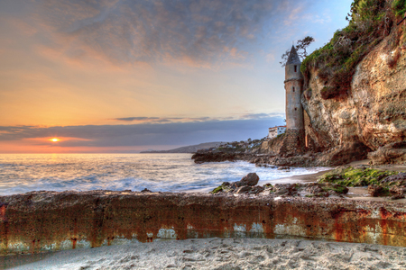 Sunset over Pirates tower at Victoria Beach in Laguna Beach, California, USA