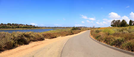 Upper Newport Bay Nature Preserve hiking trail winds along the marsh, where you will see wildlife in Newport Beach, California USA