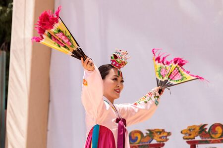 entertainers: San Diego, CA, USA – July 1, 2017: Korean fan dance performed at the San Diego Zoo Safari park. Editorial only.