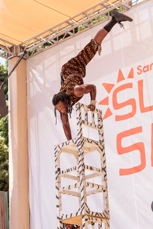 entertainers: San Diego, CA, USA – July 1, 2017: Acrobatic performance of the Zuzu African acrobats at the San Diego Zoo Safari park. Editorial only. Editorial