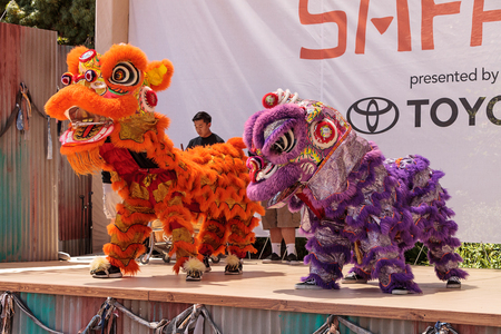 entertainers: San Diego, CA, USA - July 1, 2017: Chinese lion dance demonstration performed at the San Diego Zoo Safari park. Editorial only.