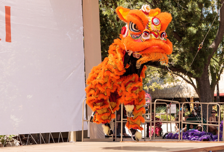 San Diego, CA, USA - July 1, 2017: Chinese lion dance demonstration performed at the San Diego Zoo Safari park. Editorial only.