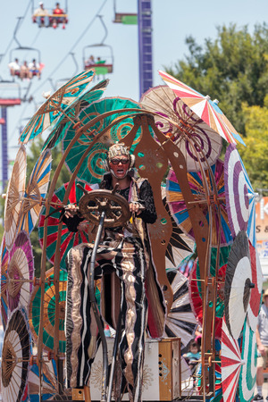 Costa Mesa, CA, USA - July 14, 2017: Theatrical circus performer Derrick Gilday, part Mango and Dango, performs with Dragon Knights steampunk stilt walkers at the Orange County Fair in Costa Mesa, CA on July 16, 2016. Editorial use only. Editorial