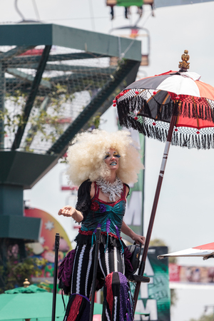 Costa Mesa, CA, USA - July 14, 2017: Theatrical circus performer Megan Fontaine, part Mango and Dango, performs with Dragon Knights steampunk stilt walkers at the Orange County Fair in Costa Mesa, CA on July 16, 2016. Editorial use only. Editorial