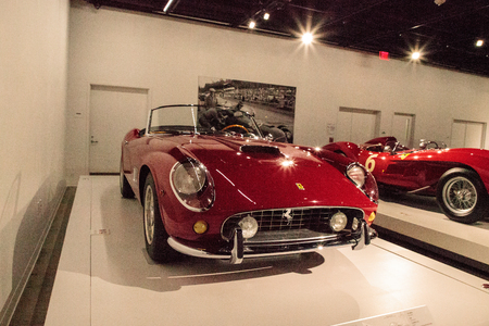 restored: Los Angeles, CA, USA - July 23, 2017: Red 1961 Ferrari 250 GT California Spyder SWB displayed at the Petersen Automotive Museum. Editorial use.